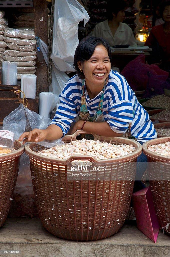A garlic vendor jokes with passers-by at Pak Khlong Talat, a huge fresh-goods market in the center of Bangkok..