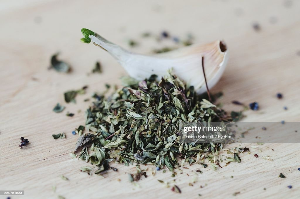 Garlic With Oregano And Poppy Seeds On Wooden Table : Stock Photo