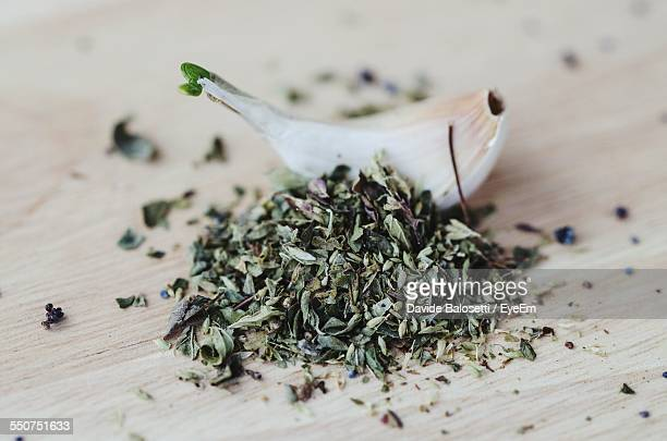 Garlic With Oregano And Poppy Seeds On Wooden Table