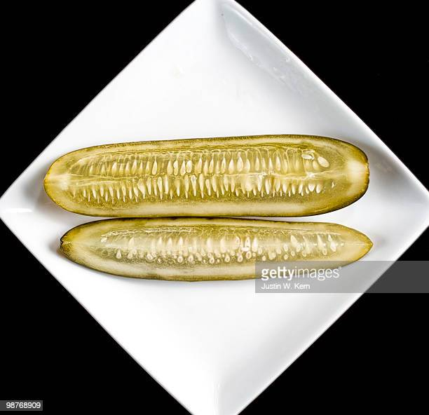garlicky dill pickles - sliced pickles stock photos and pictures