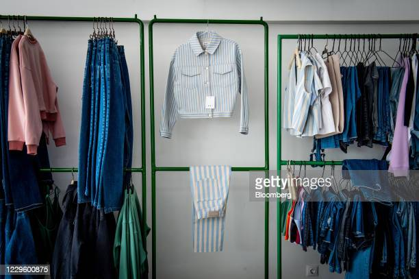 """Garment designs on display rails at the Koi studio in Tehran, Iran, on Wednesday, Oct. 14, 2020. """"Made in Iran"""" has emerged as a rare glimmer of hope..."""