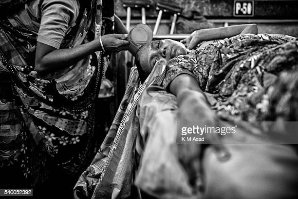A garment fights for life in Pongu hospital in Dhaka Bangladesh July 21 2013