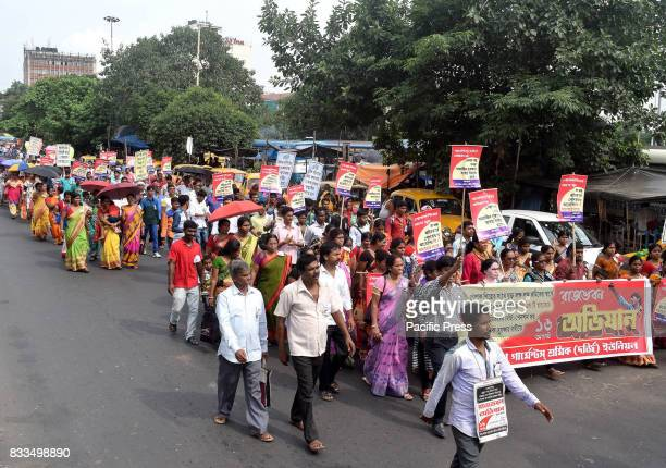 Garment Industry workers protest against GST in Kolkata Poor tailors are marching for minimum wages social security and demand for 8 hours working...