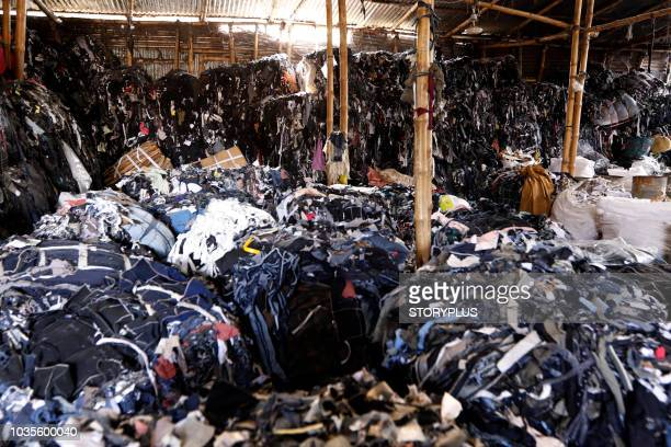 garment leftovers (waste) at a jhoot godown - landfill stock photos and pictures