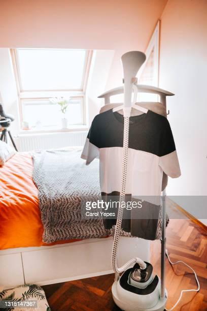 garment steamer ironing machine at home - top garment stock-fotos und bilder