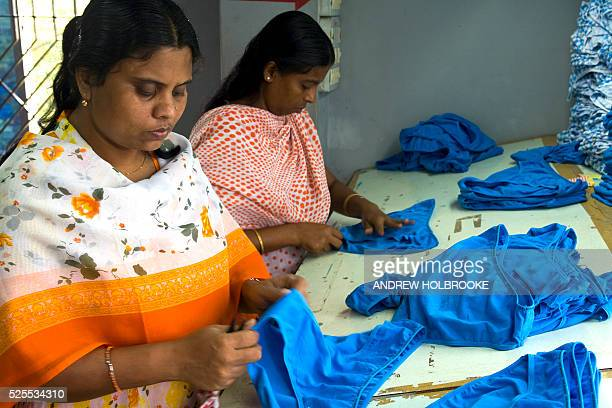 Garment workers make American owned 'JOE BOXER' brand underwear for Kmart stores in the United States US companies outsource their manufacturing to...