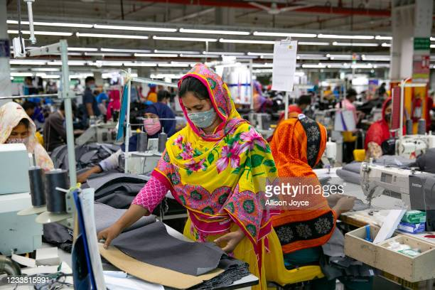 Garment workers work at a factory during a countrywide lockdown to try to contain the spread of Covid-19 on July 5, 2021 in Dhaka, Bangladesh....