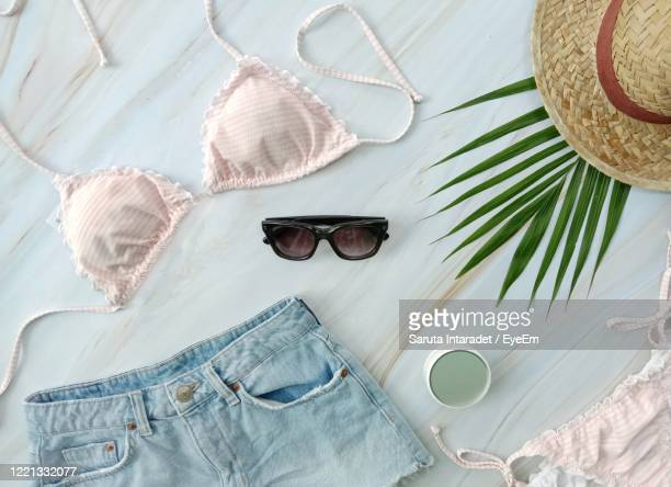 garments and sunglasses on floor - womenswear stock pictures, royalty-free photos & images