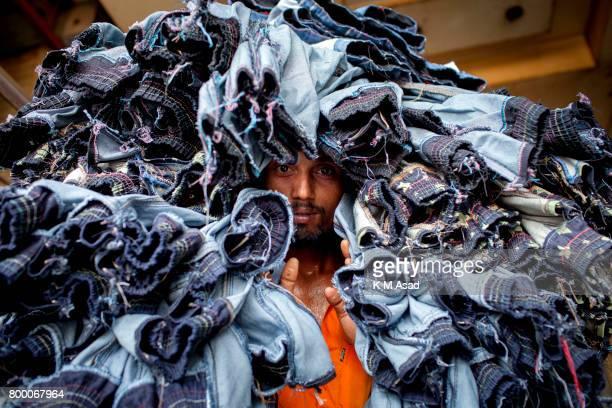 SADARGHAT DHAKA BANGLADESH Garments labourer carry denim jeans transport for local market in Dhaka
