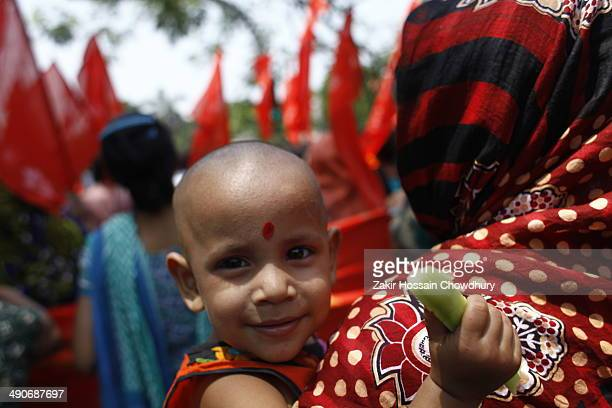 Garments worker child came with her mother for protest demanding safety work in garments sector. Garment workers form a human chain in Dhaka...