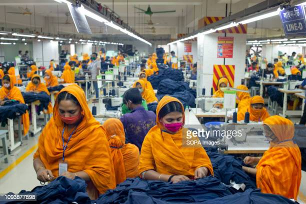 Garments workers are seen working in a sewing and finishing section Garments industry in Bangladesh drive the economy growth and it is now the major...