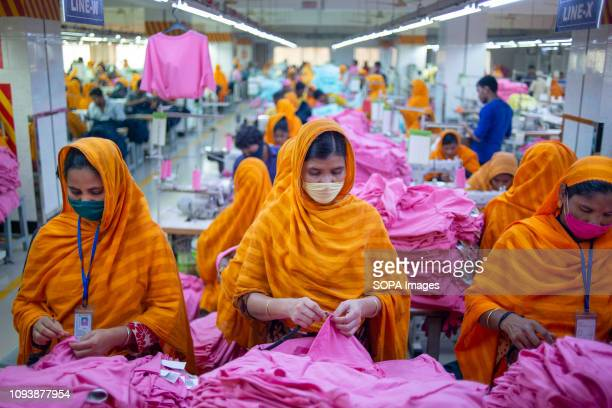 Garments workers are seen working in a sewing and finishing section. Garments industry in Bangladesh drive the economy growth and it is now the major...