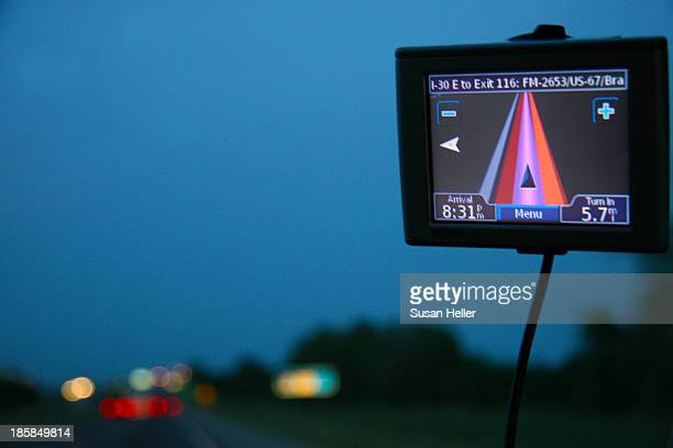 Garmin 360 GPS navigator in use in a car at dusk in East Texas while on highway I-30.