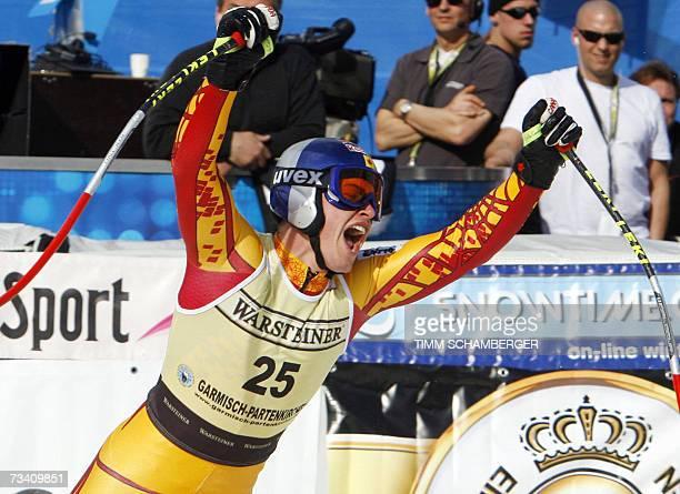 Garmisch-Partenkirchen, GERMANY: Canadian Erik Guay celebrates winning the men's downhill race of the Alpine skiing World Cup, 24 February 2007 in...