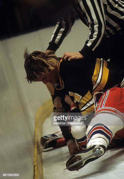 Garnet 'Ace' Bailey of the Boston Bruins fights with an unidentified New York Rangers player circa 1972 at the Madison Square Garden in New York New...