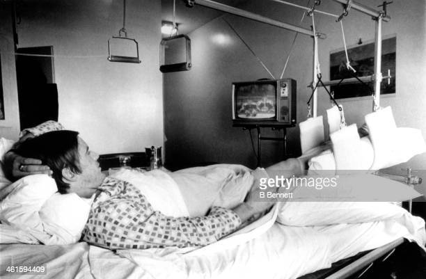 Garnet 'Ace' Bailey of the Boston Bruins watches his teammates from his hospital bed at Massachusetts General Hospital after he fractured his right...