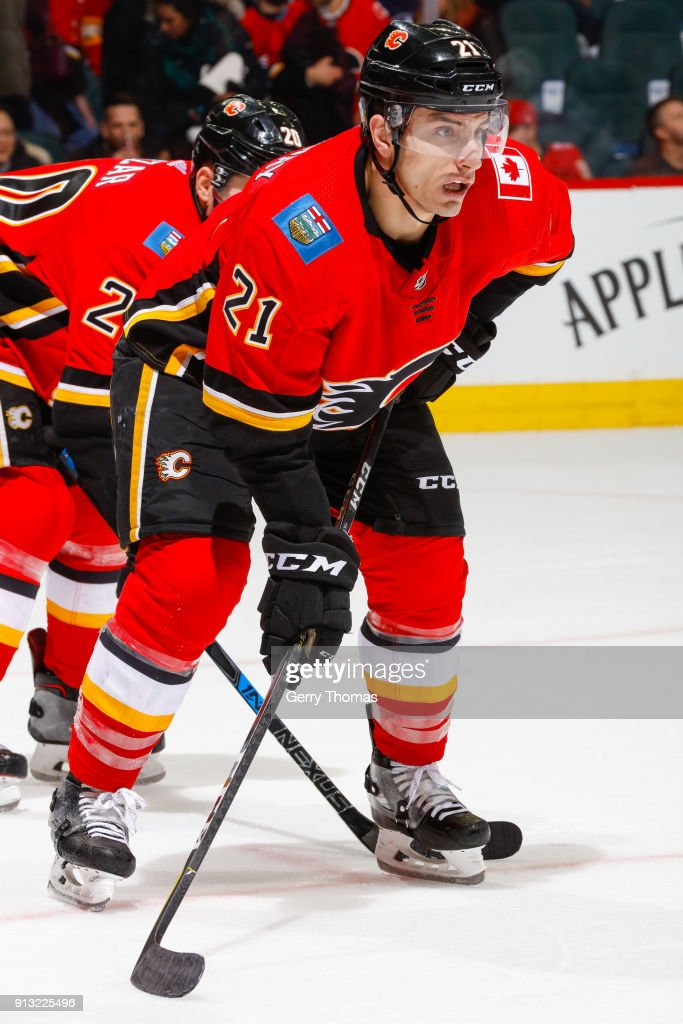 Garnet Hathaway #21 of the Calgary Flames at face off in an NHL game on February 1, 2018 at the Scotiabank Saddledome in Calgary, Alberta, Canada.