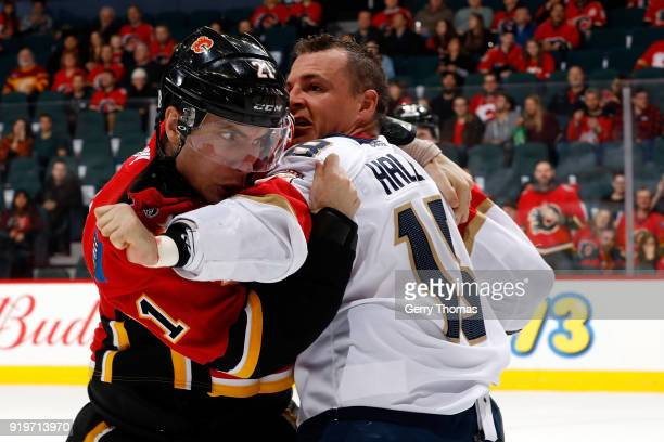Garnet Hathaway of the Calgary Flames fights Micheal Haley of the Florida Panthers during an NHL game on February 17 2018 at the Scotiabank...