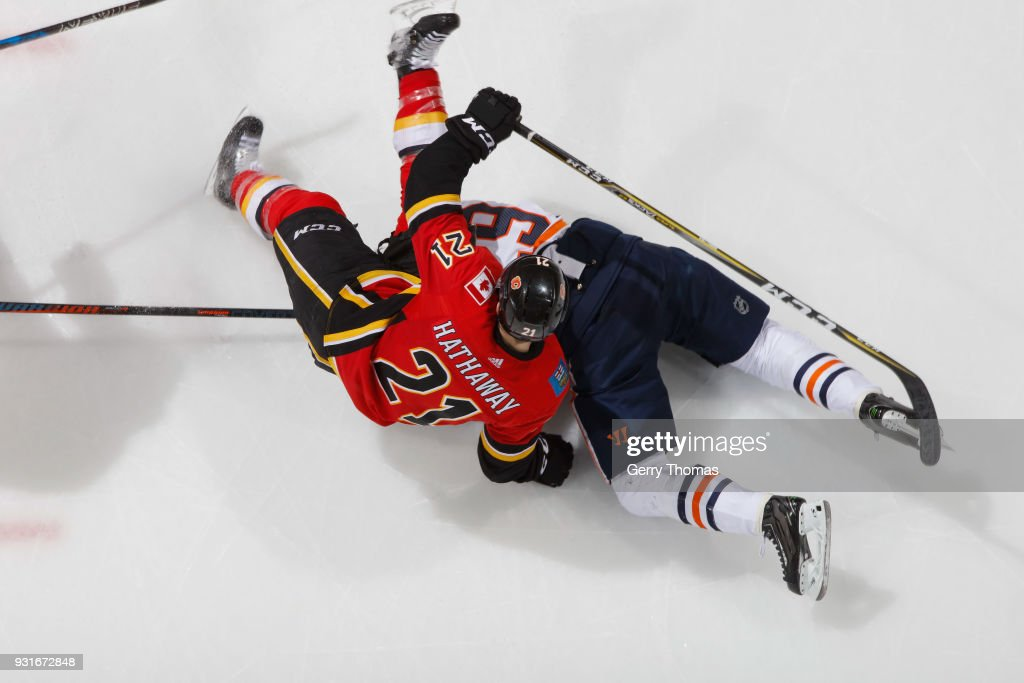 Garnet Hathaway #21 of the Calgary Flames gets tangled up against the Edmonton Oilers at Scotiabank Saddledome on March 13, 2018 in Calgary, Alberta, Canada.