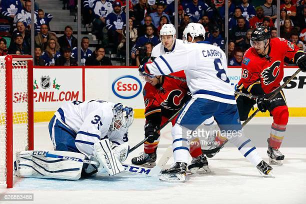 Garnet Hathaway of the Calgary Flames looks for a rebound against Jhonas Enroth of the Toronto Maple Leafs during an NHL game on November 30 2016 at...