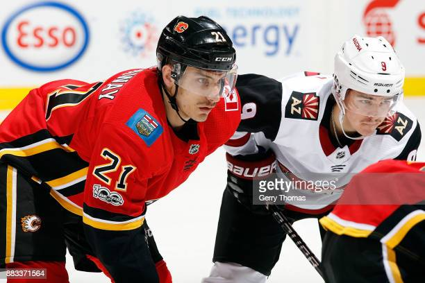 Garnet Hathaway of the Calgary Flames skates against Clayton Keller of the Arizona Coyotes during an NHL game on November 30 2017 at the Scotiabank...