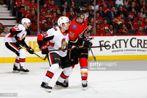 Garnet Hathaway of the Calgary Flames skates against Erik Brannstrom of the Ottawa Senators during an NHL game on March 21 2019 at the Scotiabank...