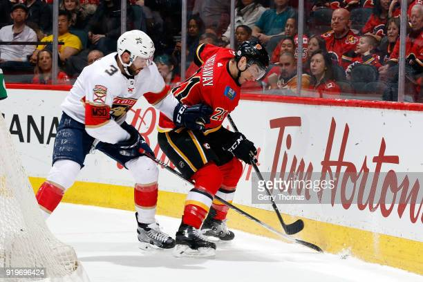 Garnet Hathaway of the Calgary Flames skates against Keith Yandle of the Florida Panthers during an NHL game on February 17 2018 at the Scotiabank...