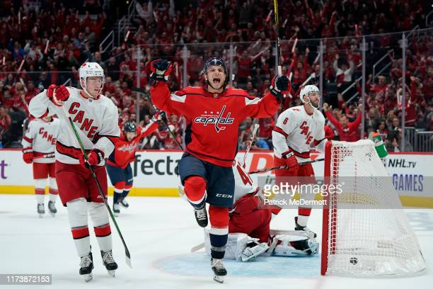 Garnet Hathaway of the Washington Capitals celebrates after scoring a goal against James Reimer of the Carolina Hurricanes in the first period at...