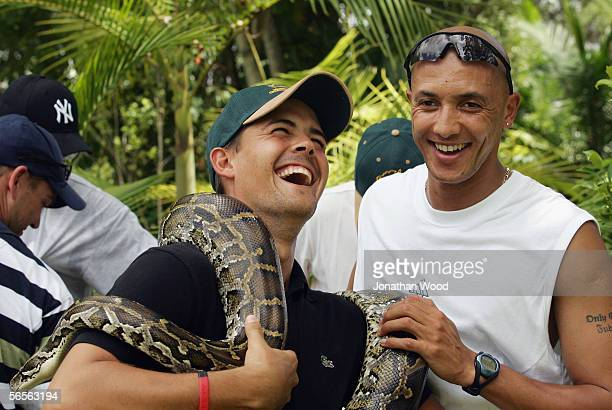 Garnett Kruger and Jacques Rudolph of South Africa hold onto a Burmese Python during a visit to Australia Zoo on January 11, 2005 on the Sunshine...