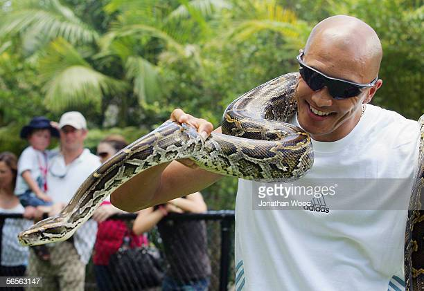 Garnett Kruger of South Africa holds onto a Burmese Python during a visit to Australia Zoo on January 11, 2005 on the Sunshine Coast, Australia.