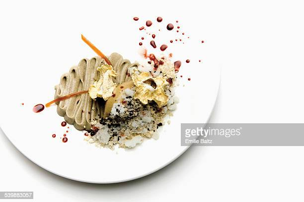 Garnished mushroom dish served in plate over white background