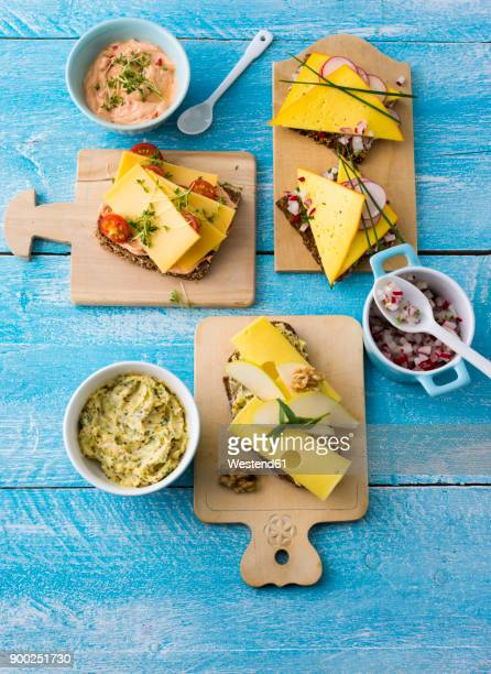 garnished sandwiches with spread and cheese - brot stock-fotos und bilder