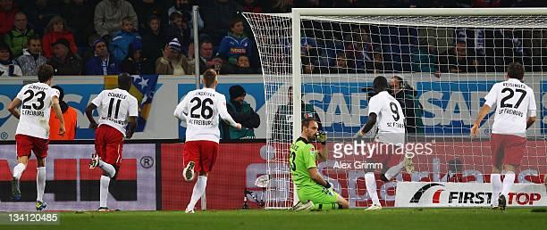 Garra Dembele of Freiburg celebrates his team's first goal with team mates Julian Schuster, Papiss Demba Cisse and Stefan Reisinger as goalkeeper Tom...