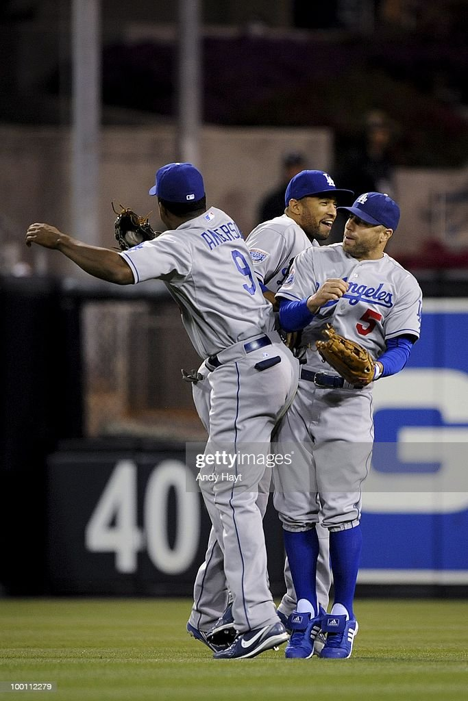 Garret Anderson #9,Matt Kemp #27, and Reed Johnson #5 of the Los Angeles Dodgers celebrate after the final out against the San Diego Padres at Petco Park on Saturday, May 15, 2010 in San Diego, California. The Dodgers won 4-1.