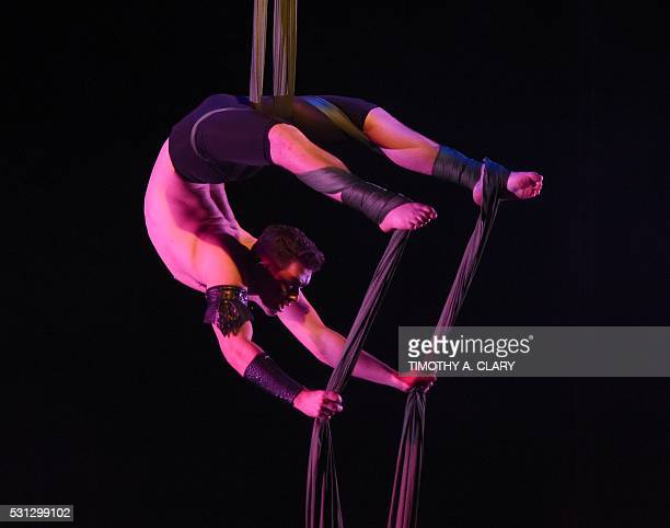Garret Caillouet of the US performs on the Men's Silks during the 2nd Annual US Aerial Championships May 13 2016 at the Baruch Performing Arts Center...