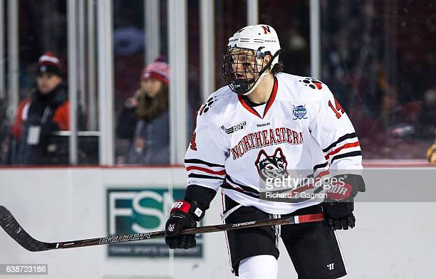"""Garret Cockerill of the Northeastern Huskies skates against the New Hampshire Wildcats during NCAA hockey at Fenway Park during """"Frozen Fenway"""" on..."""