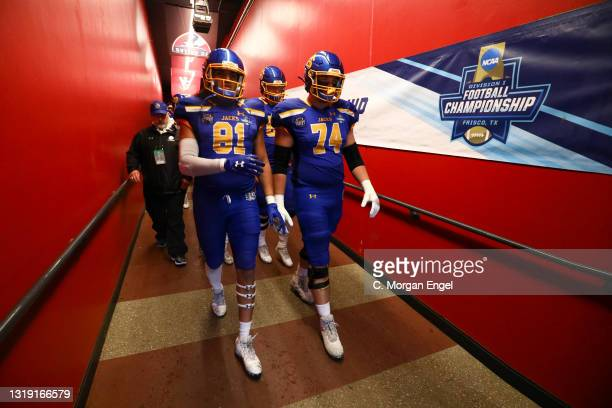 Garret Greenfield and Skyler Cavanaugh of the South Dakota State Jackrabbits walk out to the field before thegame against the Sam Houston State...