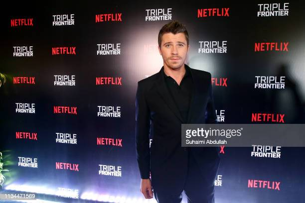 Garret Hedlund attends the fan event for the Singapore premiere of 'Triple Frontier' at The Shoppes in Marina Bay Sands on March 08 2019 in Singapore