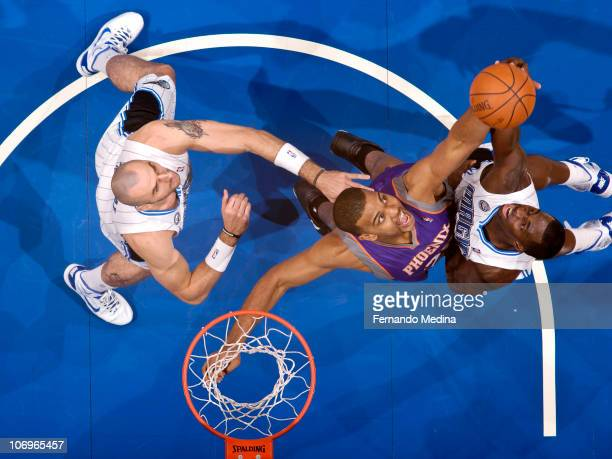 Garret Siler of the Phoenix Suns battles for a rebound against Brandon Bass of the Orlando Magic on November 18 2010 at the Amway Center in Orlando...