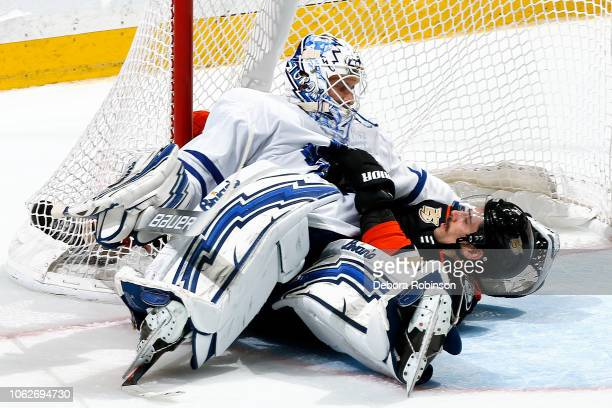 Garret Sparks of the Toronto Maple Leafs and Ryan Getzlaf of the Anaheim Ducks battle for position in the goal crease during the game on November 16...