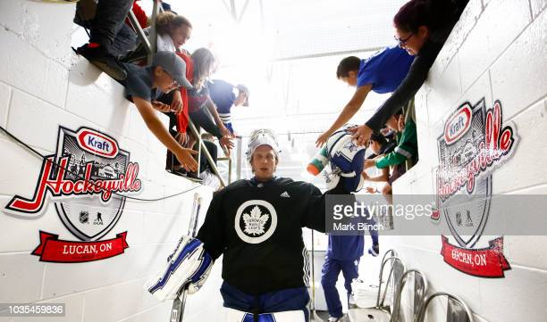 Garret Sparks of the Toronto Maple Leafs high fives fans as he exits the ice following morning skate during Kraft Hockeyville Canada at the Lucan...