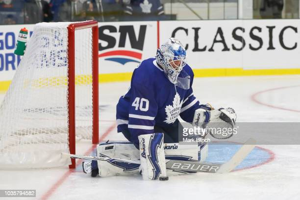 Garret Sparks of the Toronto Maple Leafs makes a blocker save during a preseason game against the Ottawa Senators during Kraft Hockeyville Canada at...