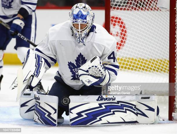 Garret Sparks of the Toronto Maple Leafs makes a save against the Chicago Blackhawks during the regular season opening home game at the United Center...