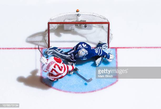 Garret Sparks of the Toronto Maple Leafs makes a save on Andreas Athanasiou of the Detroit Red Wings during the second period at the Scotiabank Arena...