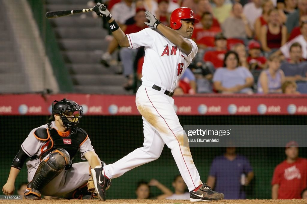 Garrett Anderson #16 of the Los Angeles Angels of Anaheim hits a single in the eighth inning against the Baltimore Orioles on September 5, 2006 at Angel Stadium in Anaheim, California.