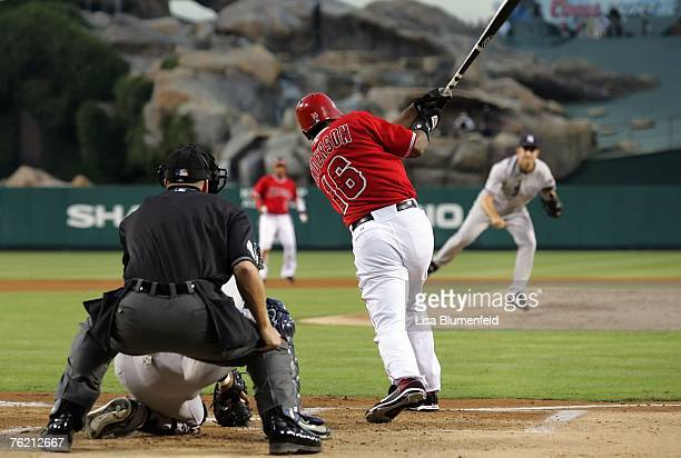 Garrett Anderson of the Los Angeles Angels of Anaheim hits a two RBI double in the first inning against the New York Yankees at Angels Stadium on...