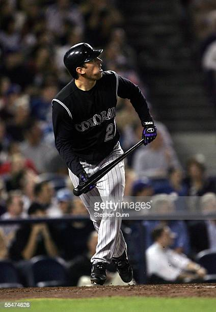 Garrett Atkins of the Colorado Rockies watches as his grand slam home run leaves the park in the fifth inning against the Los Angeles Dodgers on...
