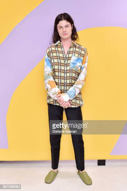 Garrett Borns attends Acne Studios West Hollywood Store Opening on March 22 2018 in West Hollywood California