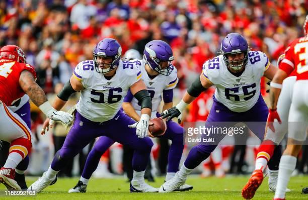 Garrett Bradbury of the Minnesota Vikings and Pat Elflein of the Minnesota Vikings pull on a first quarter run block against the Kansas City Chiefs...