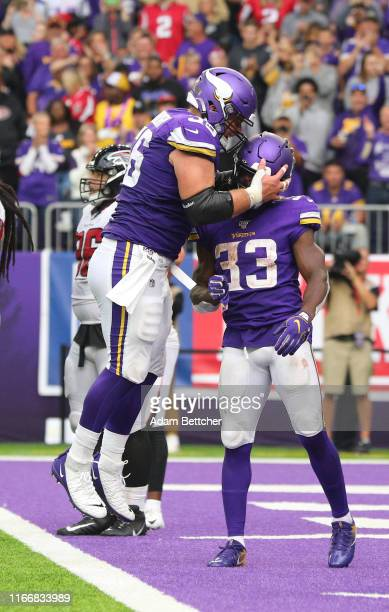 Garrett Bradbury of the Minnesota Vikings celebrates a Dalvin Cook touchdown in the third quarter against the Atlanta Falcons at US Bank Stadium on...